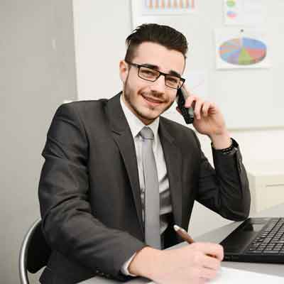 Businessman smiling on the phone.