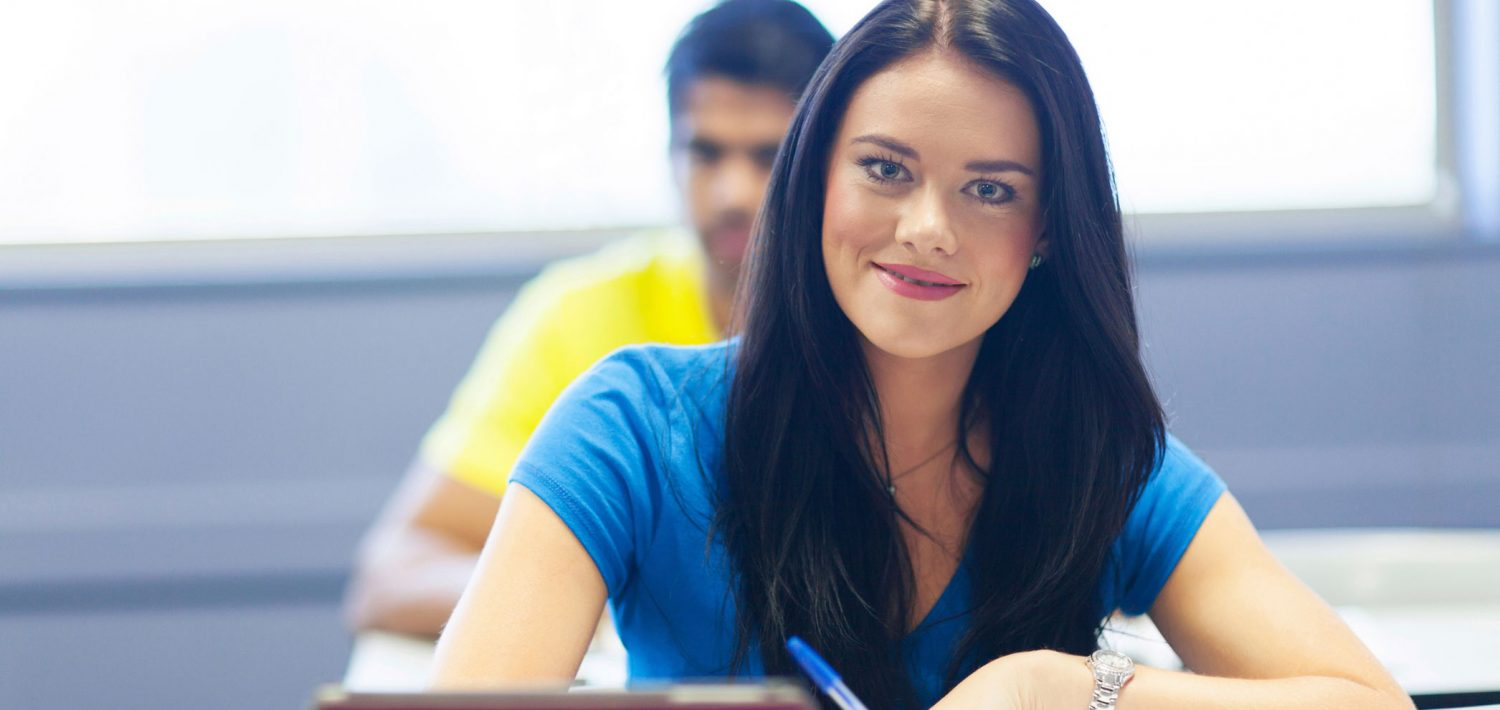 Student smiling in class.